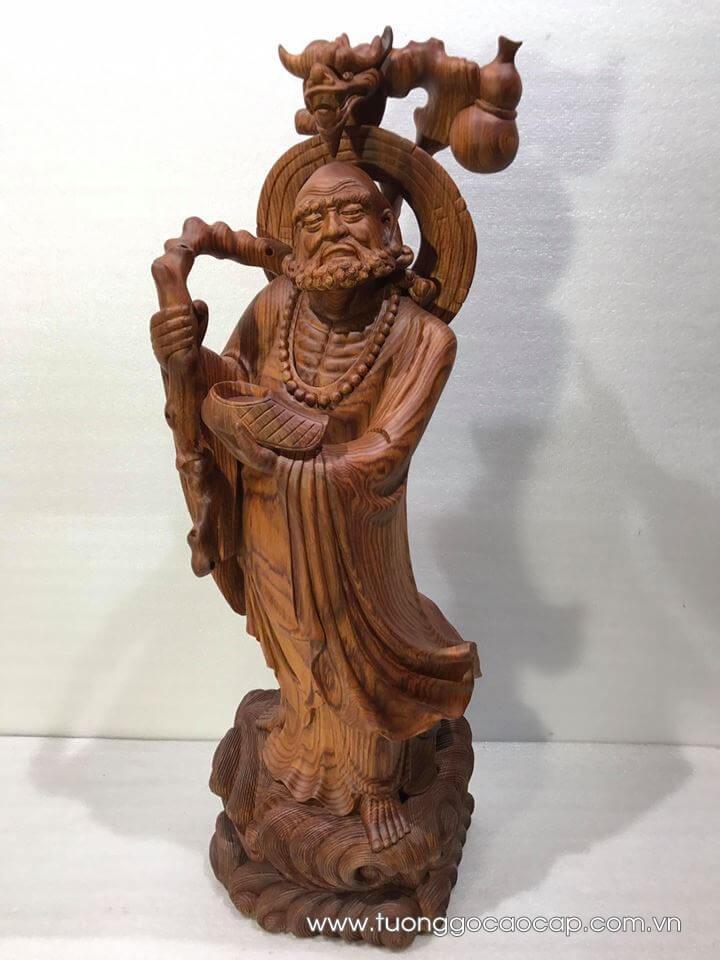 Tượng Đạt Ma quá hải gỗ hương vân 82x24x23cm