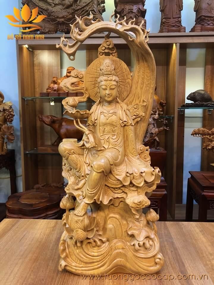 Tượng phật Quan Âm tự tại gỗ pơ mu liền khối 68x27x18cm