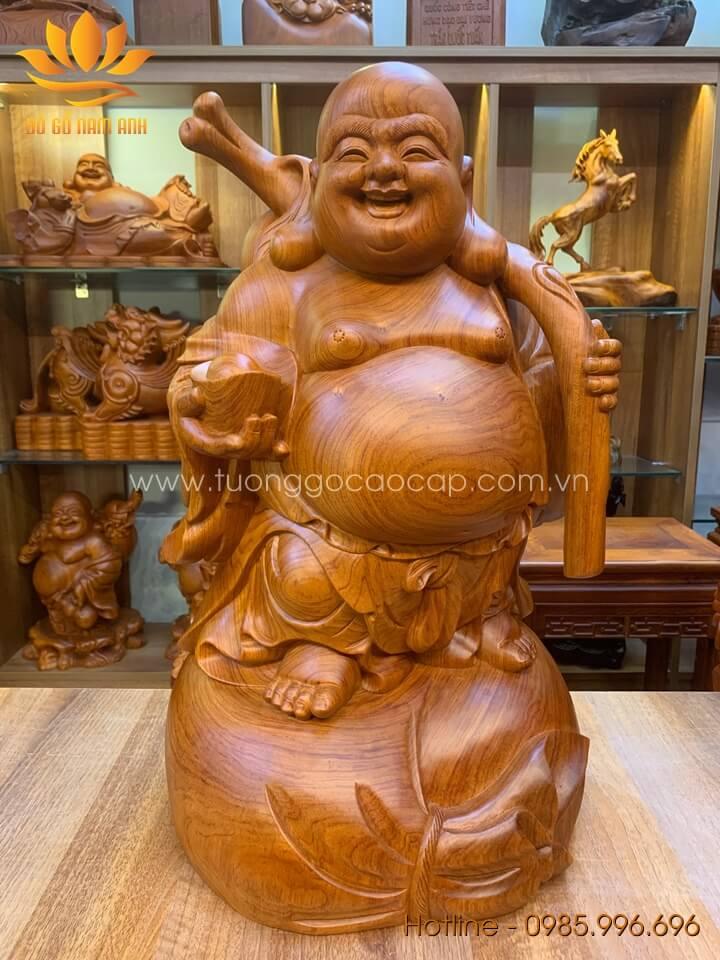 Tượng Di Lặc gánh trái đào gỗ hương liền khối 60x33x32cm